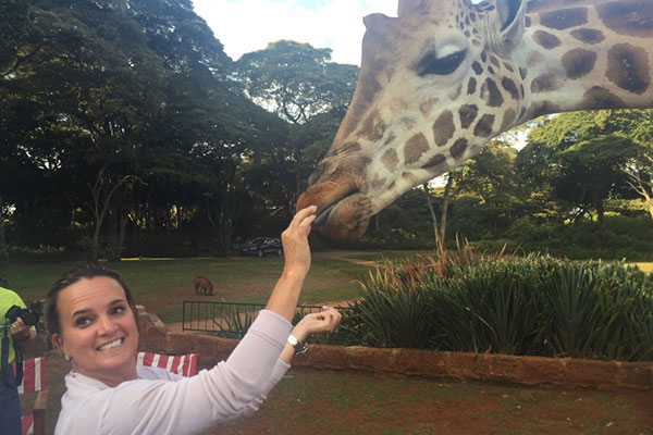 Feeding a giraffe at Giraffe Manor, Kenya