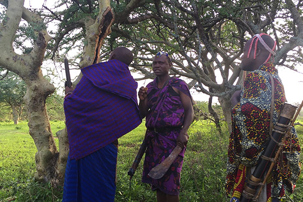 Luxury Africa Travel Specialists - Laura Tober - Walking Safari with Maasai in Tanzania - Safari Guides Finding Local Honey