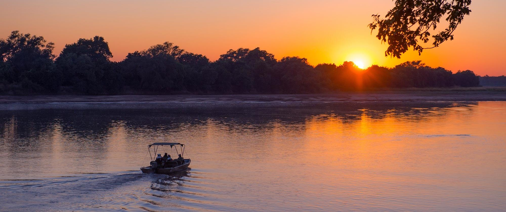 Sunset Cruise at Nkwali Camp, South Luangwa National Park - South Luangwa, Mana Pools, and Victoria Falls Adventure Package