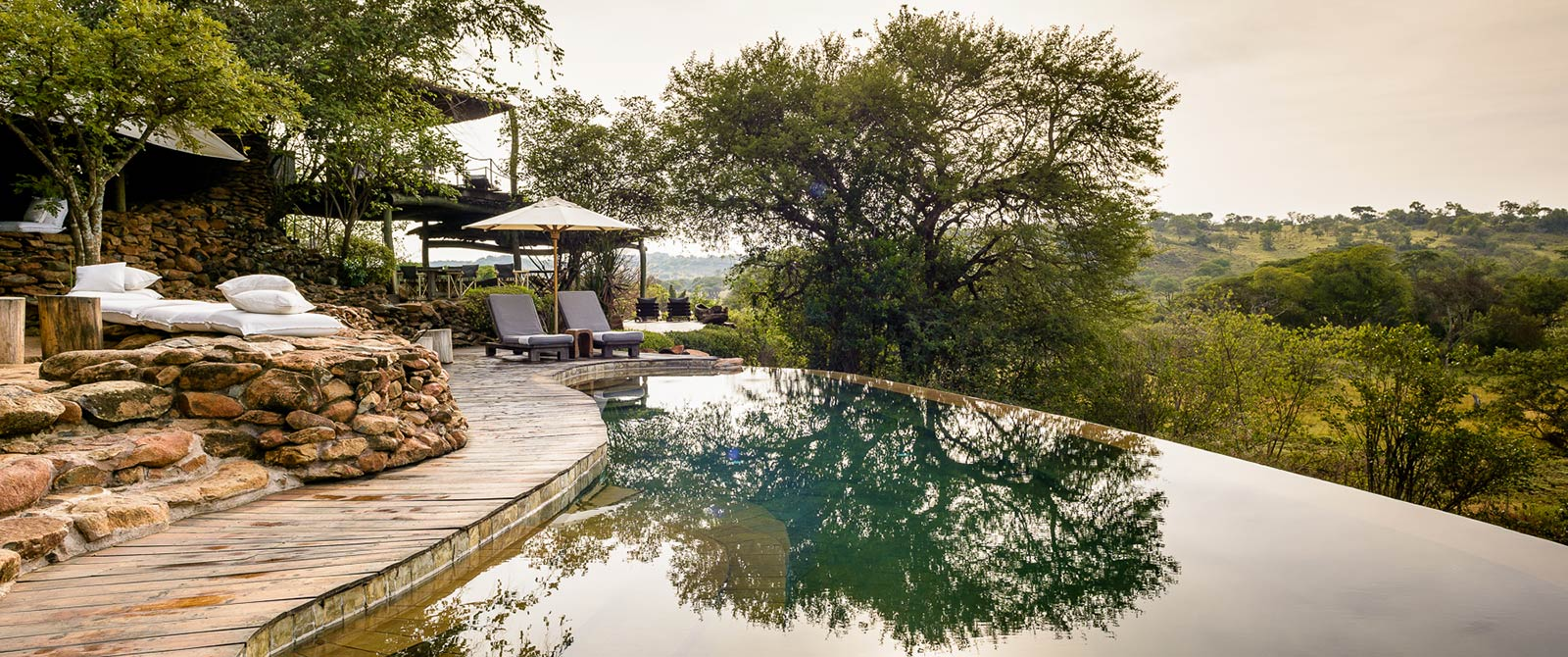 Singita Faru Faru Lodge Pool - Serengeti Great Migration Safari - Tanzania Highlights: Tarangire, Ngorongoro, and Serengeti Safari