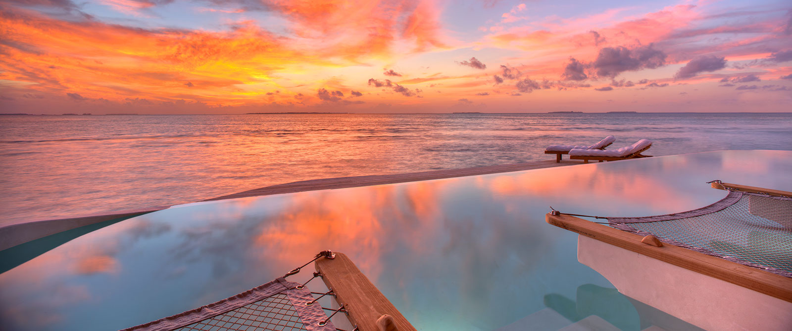 Soneva Jani Resort - Sunset View from 1 Bedroom Water Retreat with Slide - Maldives Overwater Bungalow Vacation