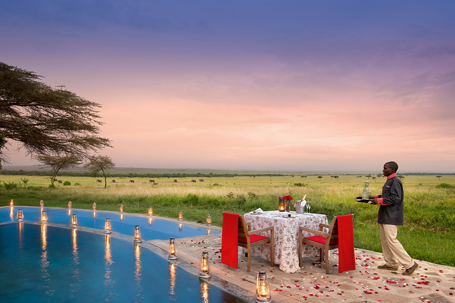 Private dining at &Beyond Kichwa Tembo Tented Camp in the Masai Mara