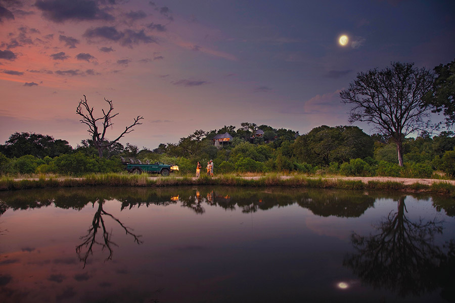 Sundowners by the water at Leopard Hills luxury lodge