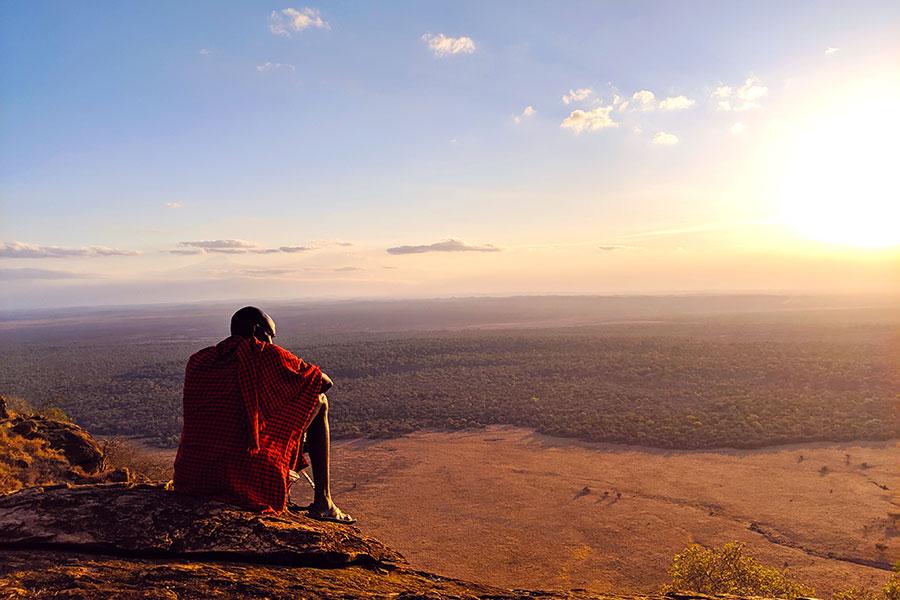 Chyulu Hills, Kenya - Maasai Warrior at Campi ya Kanzi - Image by Candice Heckel